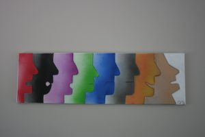 Spray paint picture of human face profiles, each one representing a different emotion