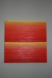 Abstract painting of a sunset with vibrant orange and yellow colours