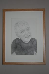 pencil and charcoal drawing of a young boy